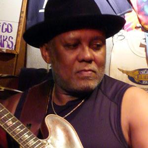 Guitarist Carlos Johnson - age: 67