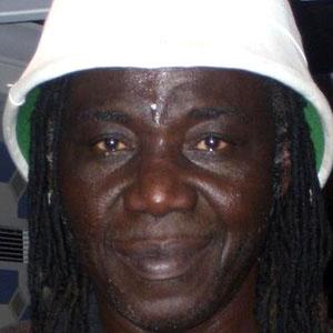 Guitarist Mamadou Diop - age: 66