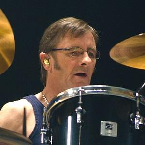 Drummer Phil Rudd - age: 66