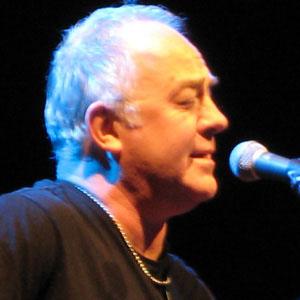 Drummer Robbie McIntosh - age: 59