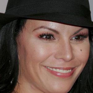 Pop Singer Olga Tanon - age: 53