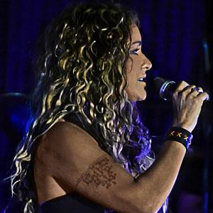 Pop Singer Rita Guerra - age: 49