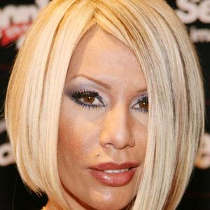 World Music Singer Ivy Queen - age: 45