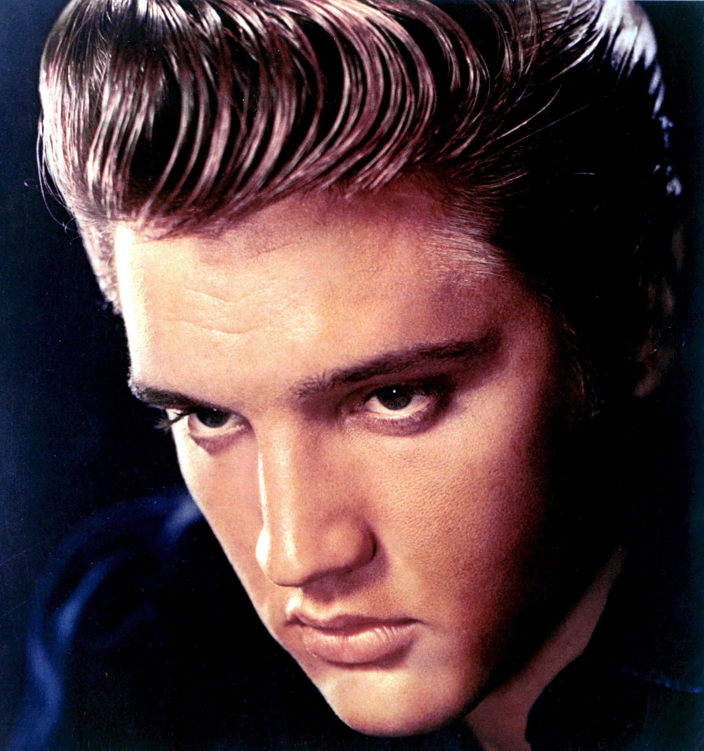Singer Elvis Presley - age: 42