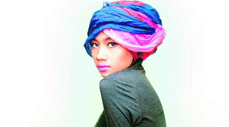 Singer-songwriter Yuna - age: 34