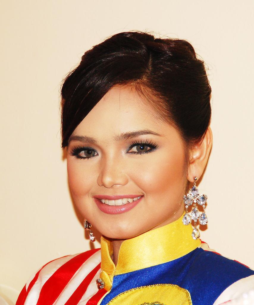 Singer Dato' Siti Nurhaliza - age: 38